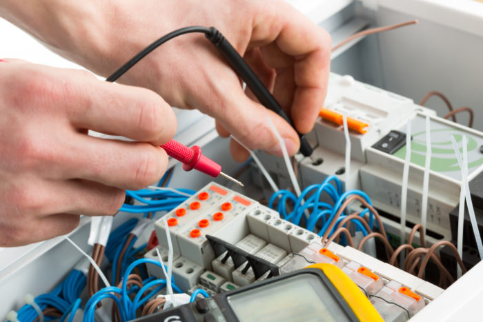 bigstock-hands-of-an-electrician-with-m-43986493